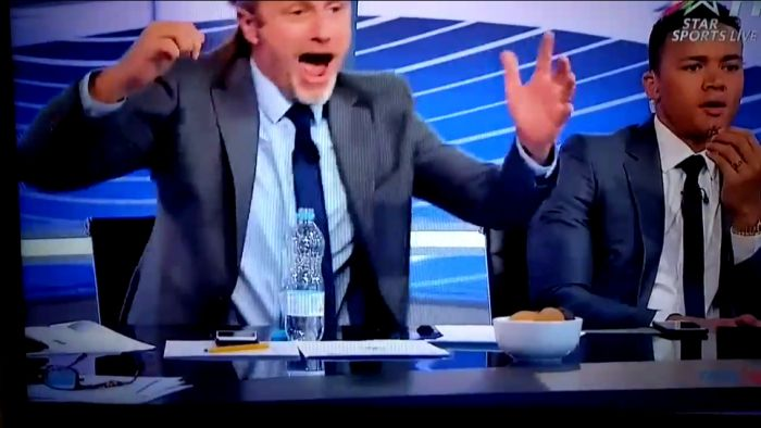 Emmanuel Petit gets a little  excited during TV punditry duties for PLTV!